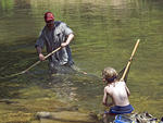 Ted Judy teaches his son how to seine in the Buffalo National River.